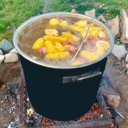 Great Lakes Fish Boil pot on the fire at the Hearth and Vine Cafe at Black Star Farms Suttons Bay.