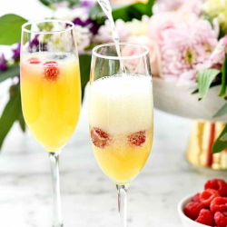 Example of mimosas you can make at home with fresh berries.