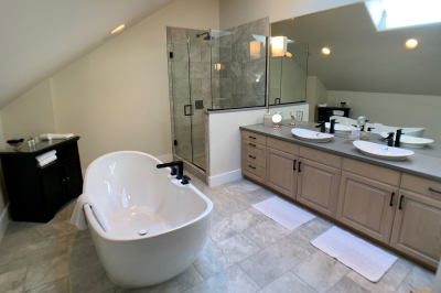 Bathroom in Atlas with large soaking tub and walk-in shower.