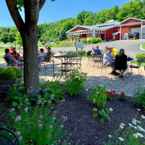 People dining outdoors on cafe patio.