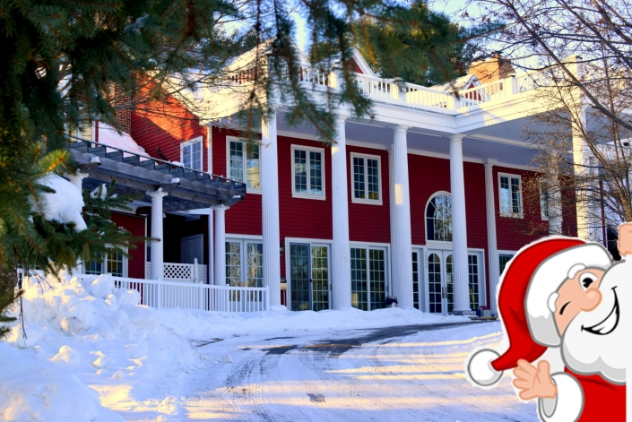 Santa waving in front of the Inn.