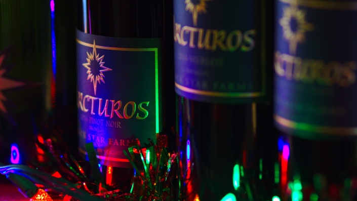 Red wine with holiday lights.