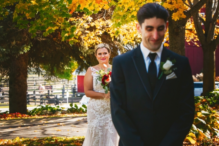 First look bride and groom with horse paddocks.