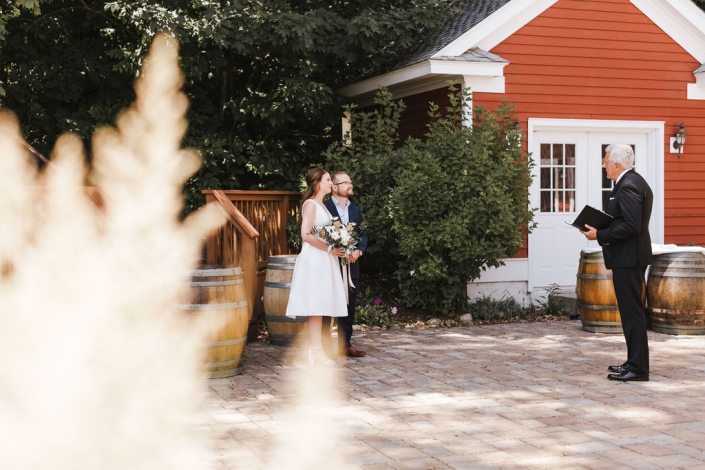 Elopement couple with officiant.