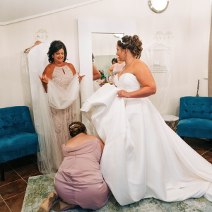 Bride getting ready in bridal suite.