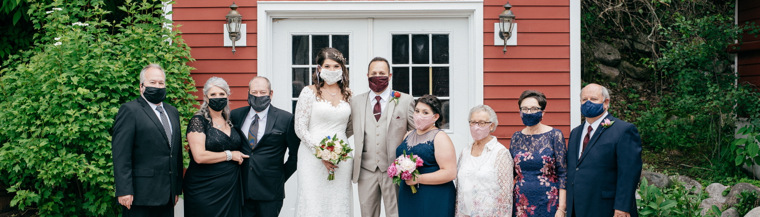 Small wedding party wearing masks.