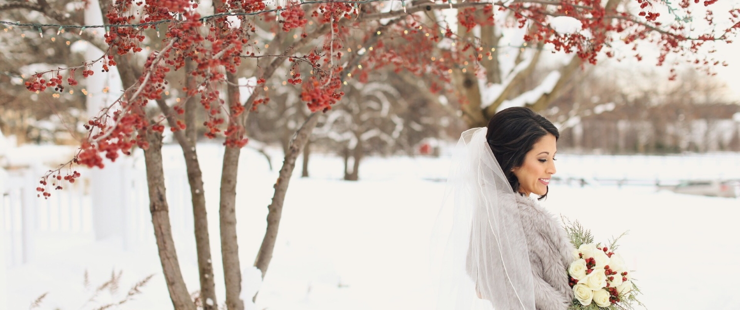 Bride with bouquet in winter scene.