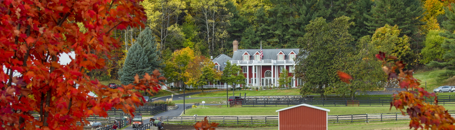 Inn with horse paddocks in the fall.