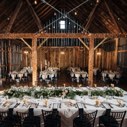 Decorated wedding reception tables in the Pegasus Barn.