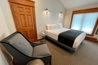Rigel room showing chair and king bed.